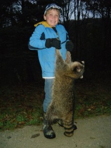 Jake, age nine, and Tommy Skarlis of Waukon, Iowa set a long line for raccoons and possums this fall and harvested 33 raccoons and 14 possums. Image courtesy Tommy Skarlis.