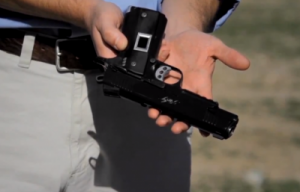 Personalized handguns such as this Intelligun-equiped 1911 pistol, are designed to be capable of firing only when held by their owners.