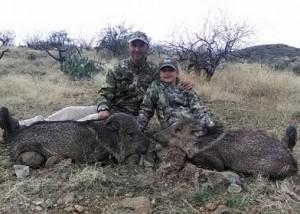 Marshall MacFarlane's daughter, Mikaela, with her first javelina and friend Josh Smith. Image courtesy Marshall MacFarlane/The Desert Rat
