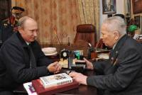Russian President Vladimir Putin was friendly with weapons designer Mikhail Kalashnikov, who invented the AK-47 assault rifle. Kalashnikov died last year. AP Photo